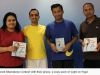 Winners of the 'Record Attendance Contest' with their prizes; a copy each of 'Light on Yoga'